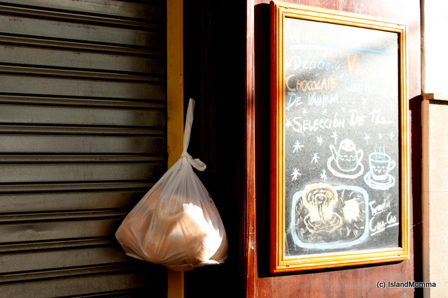 Some of the old habits linger here in any event. This bar was't open when the bakery delivery arrived, so they just hung it on the door. This happens in the villages, but can't see it in the resorts!
