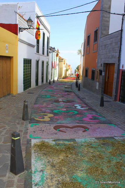 Narrow streets and floral carpets Arona