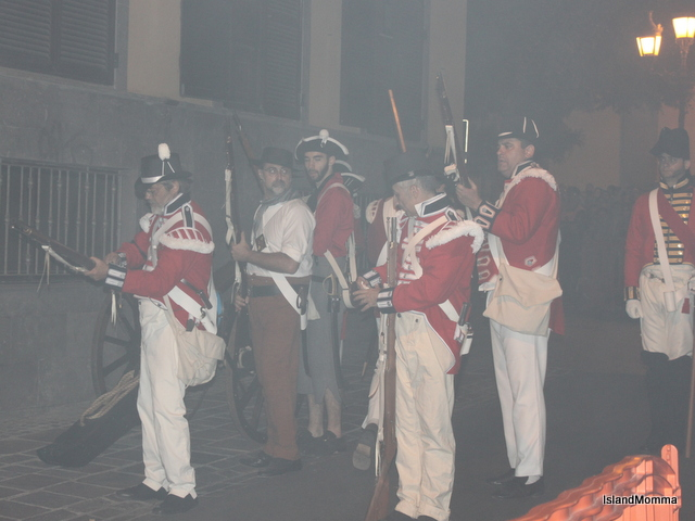 Smoke from the battle stinging their eyes, the British prepare to retreat