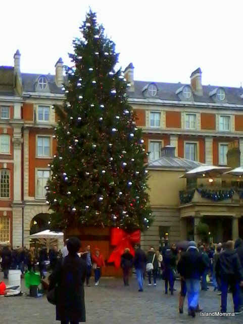 Bright red bow around the Christmas tree at Covent Garden